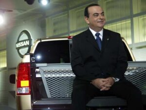 Better days: Nissan CEO Carlos Ghosn smiles as he debuts the original Titan pickup truck.