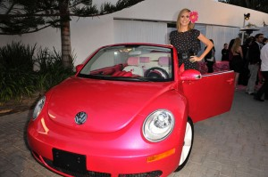 Supermodel Heidi Klum stands in for Barbie doll to take delivery of a customized Barbie Dream Car New Beetle.