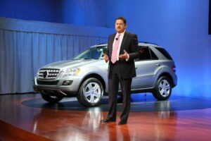 Mercedes' U.S. boss, Ernst Lieb, reveals the automaker's first hybrid-electric vehicle, the ML450.