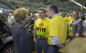 Angela Merkel chats with Opel employees