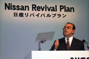 Nissan is reporting its first loss in a decade -- a setback for CEO Carlos Ghosn, who is shown here announcing the Nissan Revival Plan, in October 1999.