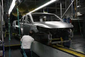 Despite deep cuts in both production capacity and the number of models offered by makers, such as Chrysler -- workers shown here building the Town & Country minivan -- a new study warns that the U.S. market remains dangerously over-crowded.