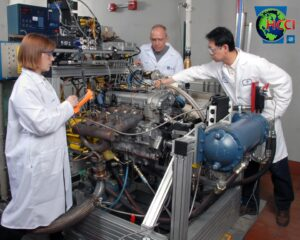 Members of the GM's HCCI team preparing a prototype engine for testing.