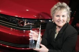 Saturn General Manager Jill Lajdziak accepts the award for the midsize Aura, named North American Car of the Year at the 2007 Detroit Auto Show.
