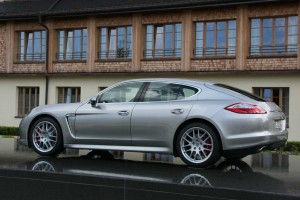 Its bid to acquire the bigger Volkswagen now in tatters, the debt-ridden sports car maker Porsche - which recently launched the Panamera, shown here - has agreed to be acquired by its larger rival.
