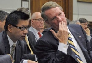 GM CFO Ray Young huddles with former Chairman Rick Wagoner during a Washington hearing called to discuss the automaker's request for a federal bailout.