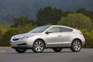 Acura is the latest maker to offer up a coupe-like sedan, shown here, for the first time, in production trim.