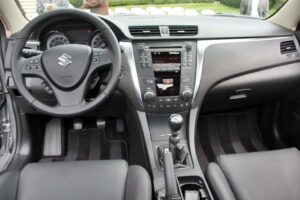 The interior of the 2010 Suzuki Kizashi is decidedly up-market from the automaker's earlier offerings, though Suzuki remains cautious about much of the latest tech features.