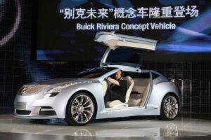 Buick unveils its Riviera concept vehicle in Shanghai.  The booming Chinese market is helping GM and Ford offset declining sales in the U.S.