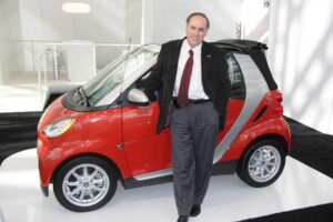 Could an extra pair of doors and a back seat expand the appeal of Smart's cars, the fortwo model shown here with CEO Dave Schembri?