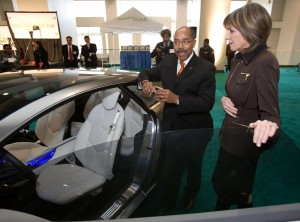 Carol Browner (right) director of the Office of Energy and Climate Change listens as General Motors Vice President Global Design Ed Welburn gives her a tour of the Cadillac Converj electric luxury coupe.