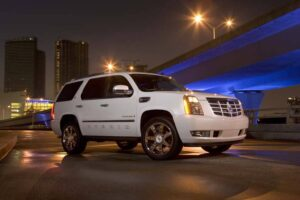 GM's two-mode hybrid has yielded significant fuel economy gains in vehicles like the 2010 Cadillac Escalade, but a more advanced four-mode system is under development.