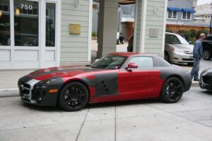 The thin disguise does little to hide the shape and dimensions of the 2011 Mercedes-Benz SLS.