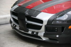 Some tape and a couple frames attempt to mislead the eye when it comes to the front end design of the 2011 Mercedes SLS, but the German maker's big tri-star badge on the grille is still quite obvious.
