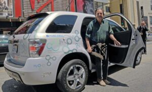 "Actor Bo Bridges tries out a hydrogen-powered Chevrolet Equinox. The latest GM fuel cell ""stack"" is lighter, smaller and far less expensive."