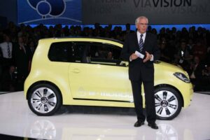 Governments may force the industry to build battery cars, like the 2013 Volkswagen e-Up, but governments will also need to subsidize their sale, says VW's global technology chief, Ulrich Hackenberg.
