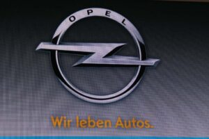 "Opel brought this new logo to Frankfurt, along with a new slogan: ""Wir Leben Autos,"" or ""We Love Cars."""