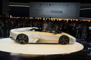 CEO Stephan Winklemann drives onto the stage in a 2010 Lamborghini Reventon Roadster, of which only 15 will be built.
