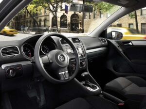 The 2010 Volkswagen Golf's interior is simple but well-appointed, with far less hard plastic than the prior model.
