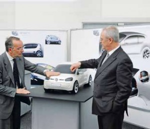 "Head of Group Design Walter de Silva, left, describes his design philosophy of ""Simplicity and character, esthetics and precision"" to Dr. Martin Winterkorn, Chairman of Volkswagen Board of Management, right."