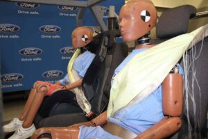 These child-sized crash dummies are wearing the new inflatable seatbelts Ford will introduce on the 2011 Explorer.