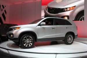 The first car to roll out of the Korean carmaker's new U.S. assembly plant, the 2011 Kia Sorento.