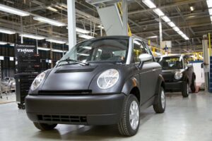The First THINK City battery cars roll down the line at a new plant in Finland that also produces Porsche Boxsters.
