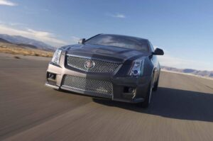 The mesh grille is the most immediate visual cue this is the 2011 Cadillac CTSv Coupe.