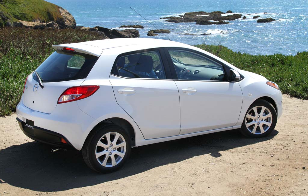 http://www.thedetroitbureau.com/wp-content/uploads/2010/08/2011-Mazda2-lighthouse-rear-3-4.jpg