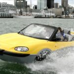 Gibbs Chairman Neil Jenkins, who is driving this Gibbs Aquada in New Zealand, says an amphibious car would cost only 15% more than a conventional car if developed from scratch.