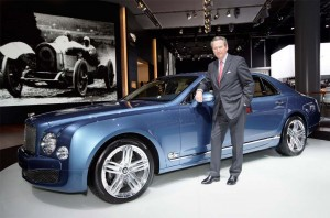 In with the new car, out with the old CEO. Franz-Josef Paefgen poses with the second-generation Bentley Continental GT.