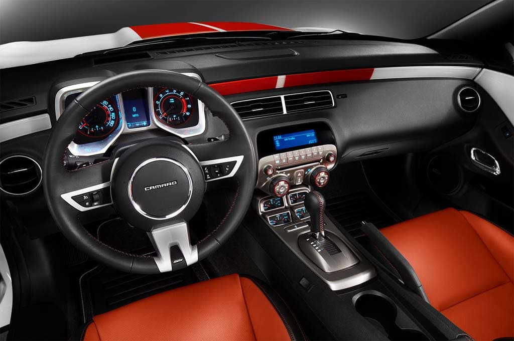 The Interior Of The Camaro Pace Car Picks Up On The Orange Exterior Accents.