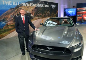 Retiring Ford CEO Alan Mulally poses with the 2015 remake of the Mustang.