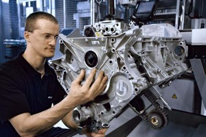 A worker at the AMG engine plant. Aston and AMG will work together on a new V-8.