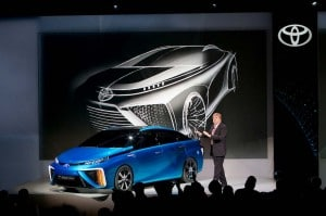 Toyota's Bob Carter showed off the FCV hydrogen car concept vehicle at CES. A production model debuts next year.