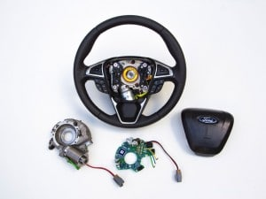 "Ford's new ""adaptive steering"" module, which was developed with Takata, will be available next year on certain models."