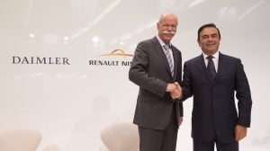 Daimler AG's Dieter Zetsche, left, and Renault-Nissan's Carlos Ghosn shake hands after announcing plans to build luxury cars in a plant in Mexico.