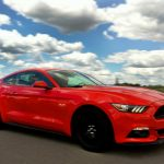 The 2015 Ford Mustang GT boasts 435 horsepower and a power-to-weight ratio comparable with some supercars.