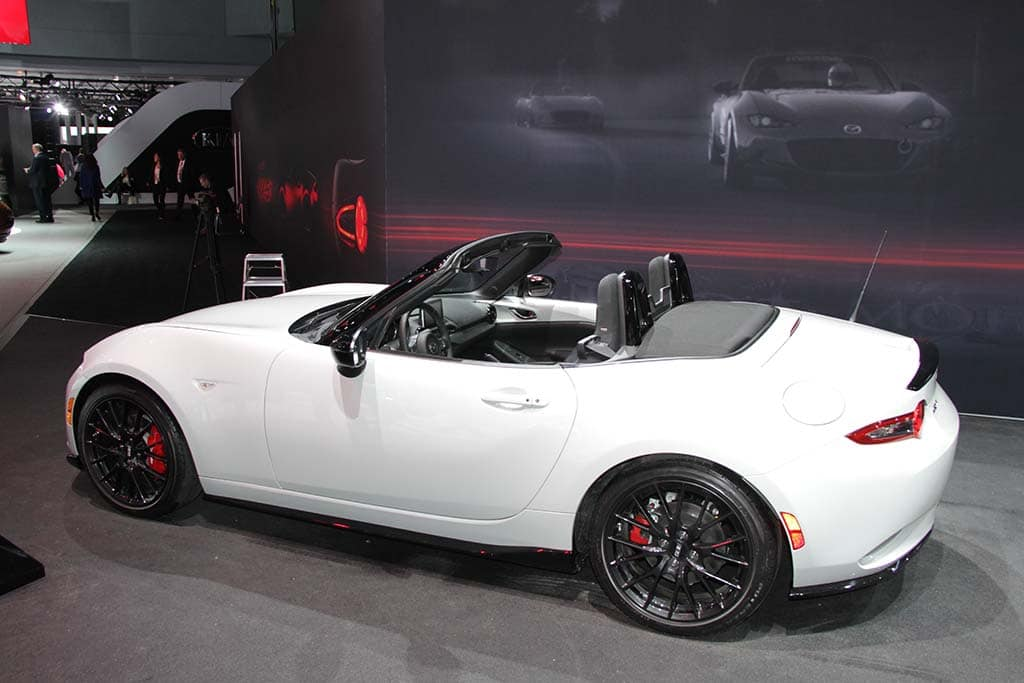 mazda s new miata mx 5 hits new york stage mazda miata club car rear 3 4. Black Bedroom Furniture Sets. Home Design Ideas