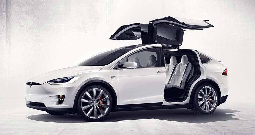 The new Tesla Model X spreads its wings -- or, more precisely, its ...