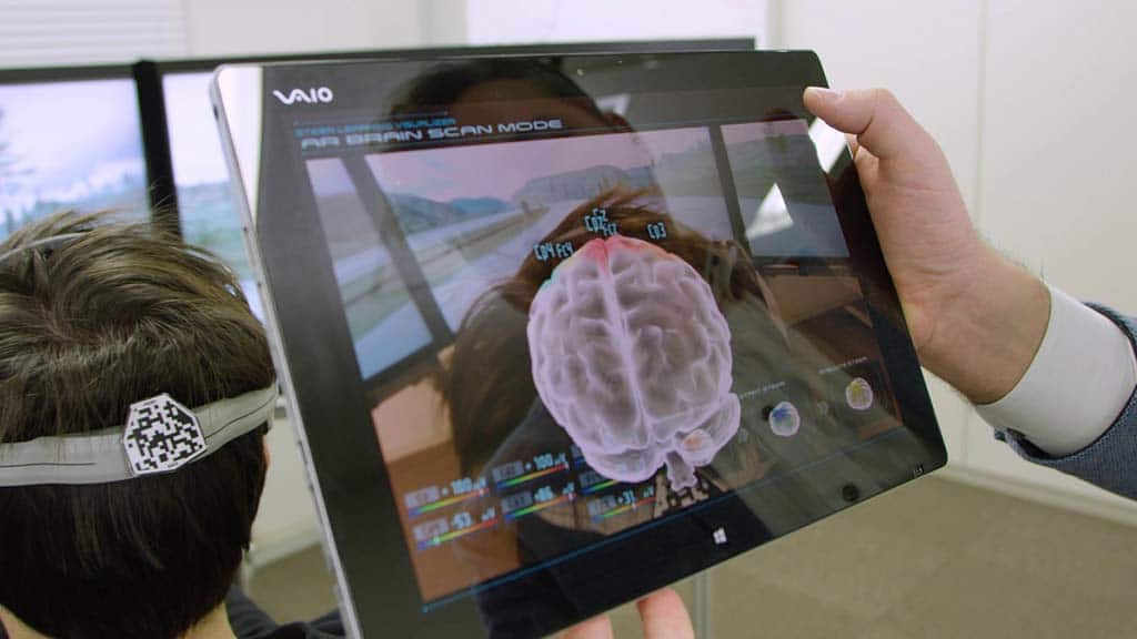 A Nissan engineer monitors a volunteer's brain activity while testing new brain-to-vehicle software