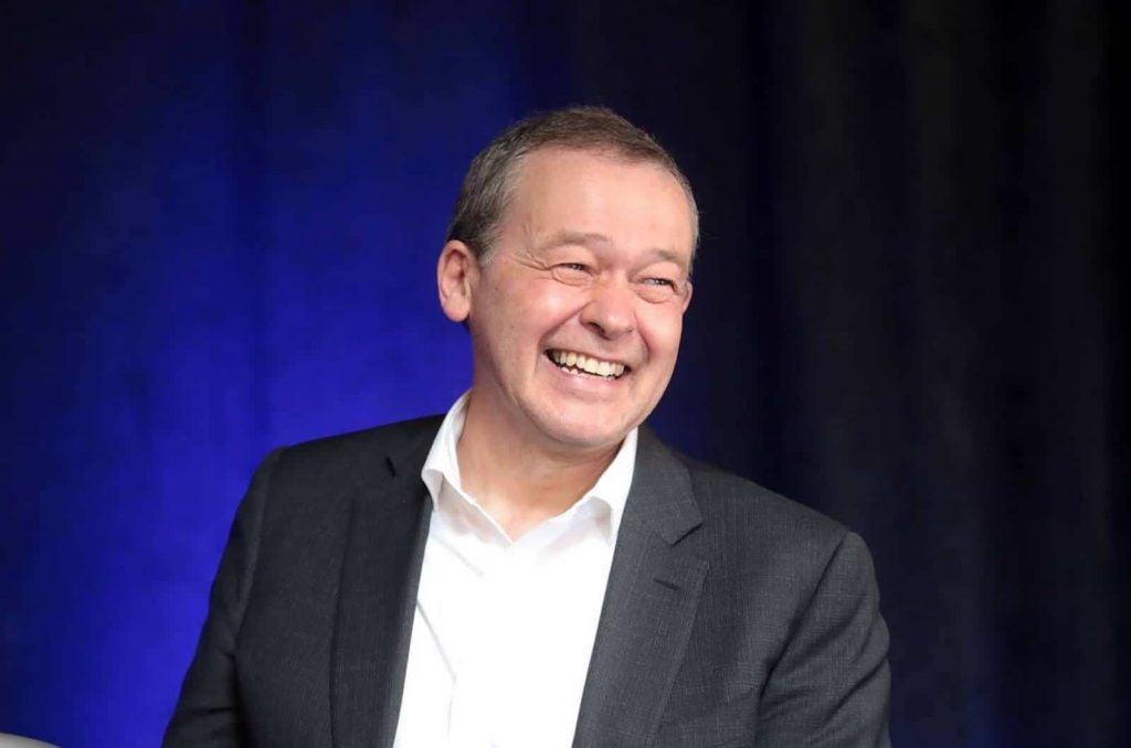 Lucid CEO Rawlinson smiling