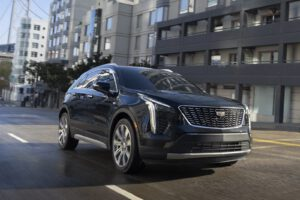 2021 Cadillac XT4 driving blue