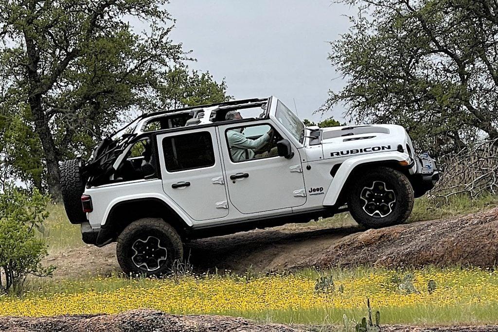 2021 Jeep Wrangler Rubicon 4xe white climbing