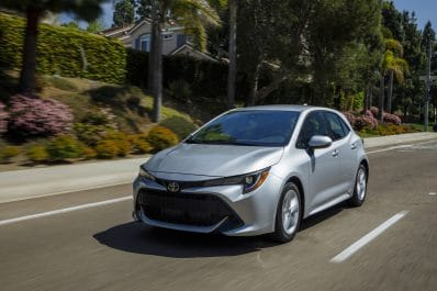 2021 Toyota Corolla hatchback driving silver