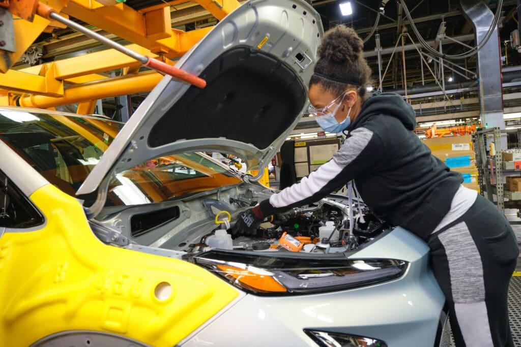 Orion worker assembles 2022 Bolt